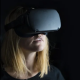 WELL poster person with VR helmet